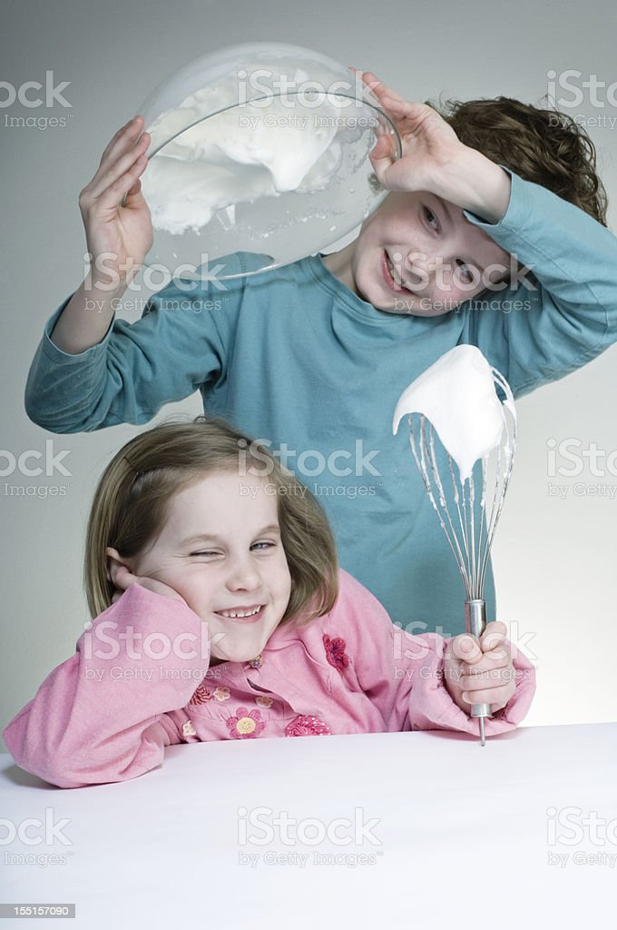 Brother and Sister Making Meringues stock photo