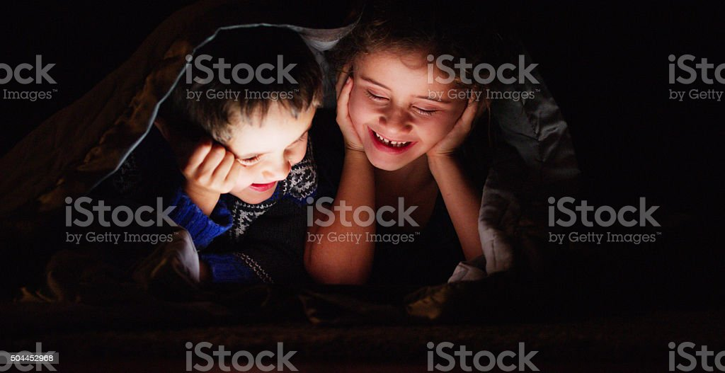 Brother and Sister Movie Night stock photo