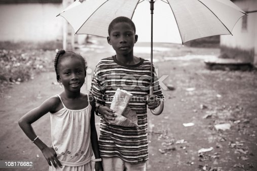 african kids out in rainy day.
