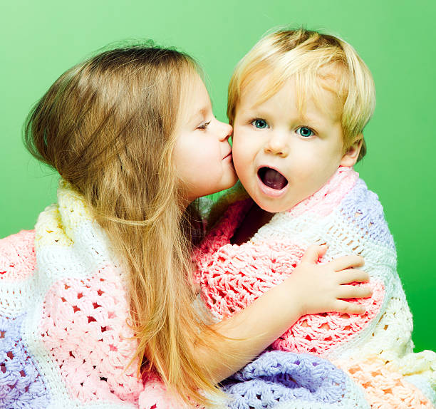 brother and sister - little girls little boys kissing love stock photos and pictures
