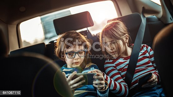 istock brother and sister 641067110