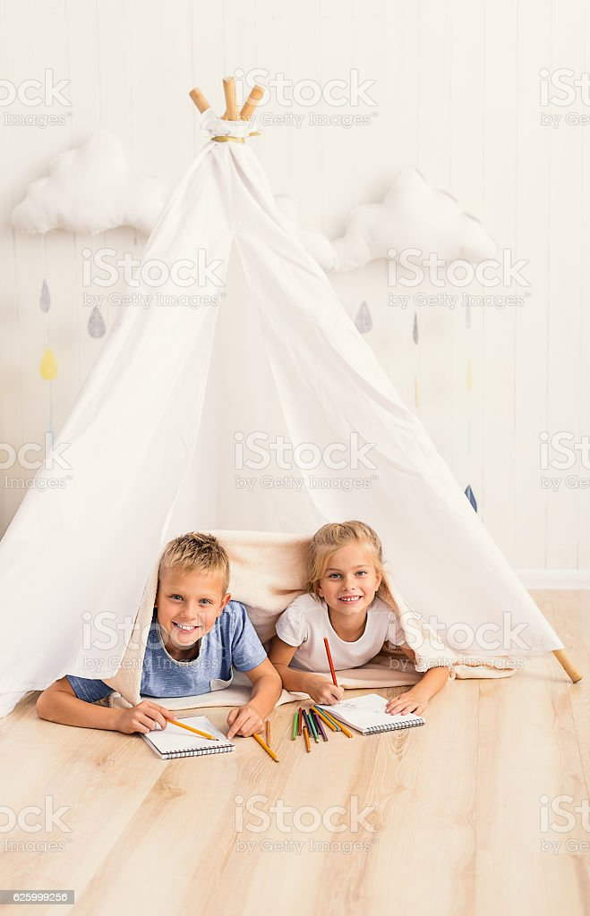 Brother and sister playing in lodge stock photo