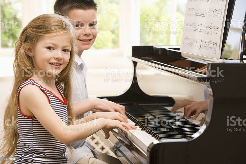 Brother And Sister Playing Piano stock photo