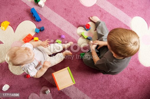 470874196istockphoto Brother and sister playing with toy blocks 177114596
