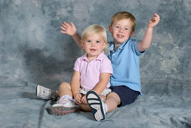 Brother and Sister Portrait Sitting stock photo