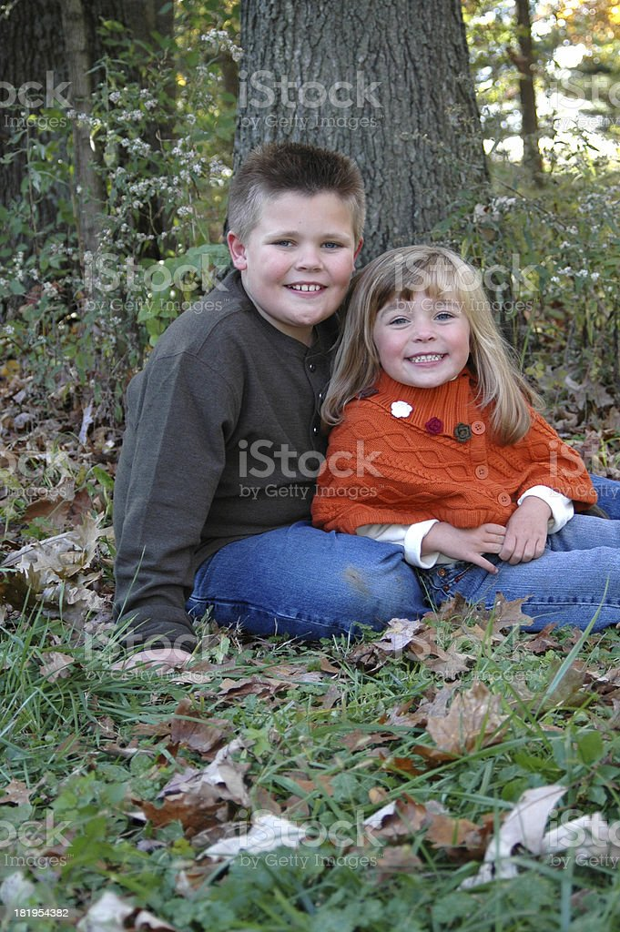 Brother and Sister Posing in the Fall stock photo