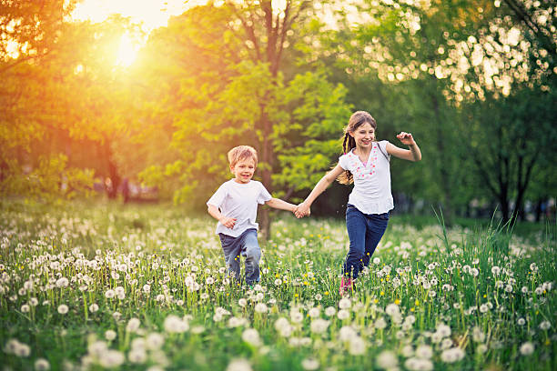 Brother and sister running in dandelion field picture id473738364?b=1&k=6&m=473738364&s=612x612&w=0&h=aa8rinqtl44dqlt5wvrnsiancbvadkktifbfrpkdvxw=
