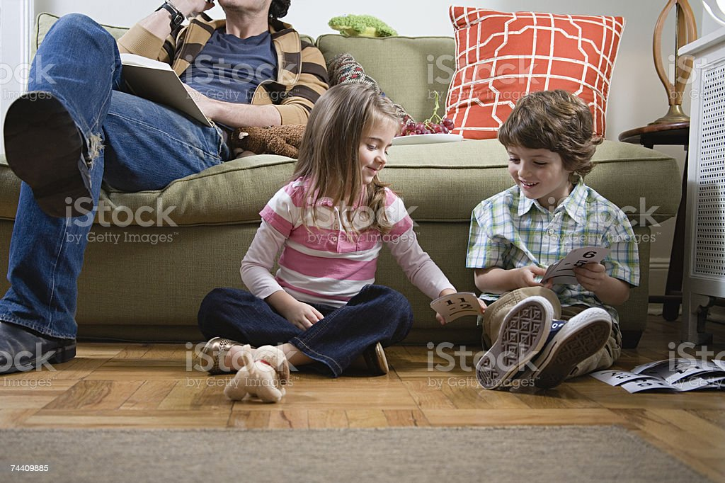 Brother and sister sitting on floor foto de stock royalty-free