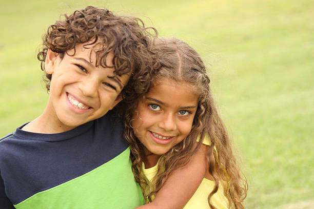 brother and sister smiling - sister stock photos and pictures