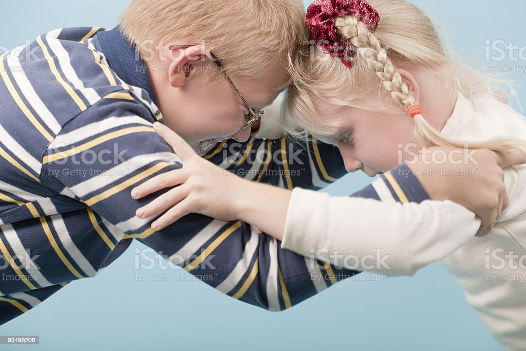 Brother and sister start a fight with each other stock photo