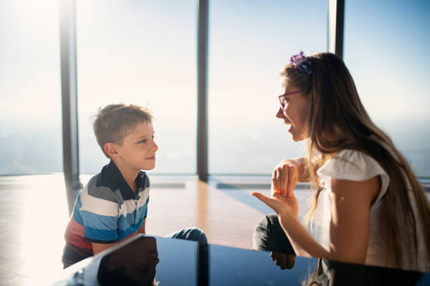 brother and sister talking in sign language - sign language stock photos and pictures