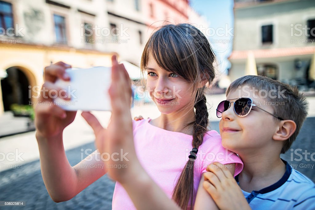 Brother and sister tourist taking selfie stock photo