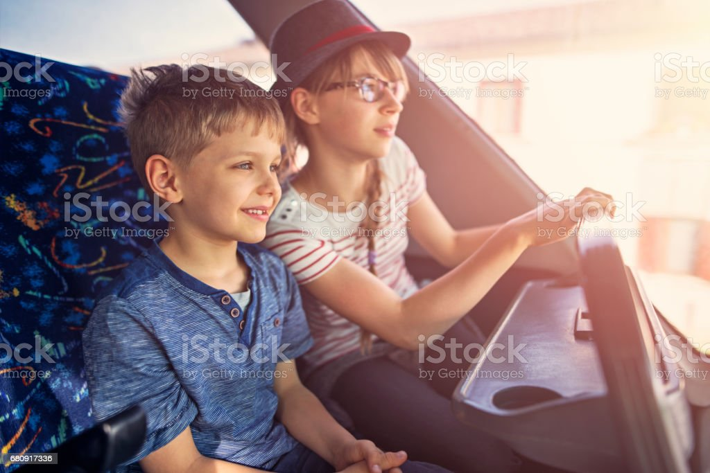 Brother and sister travelling by bus royalty-free stock photo