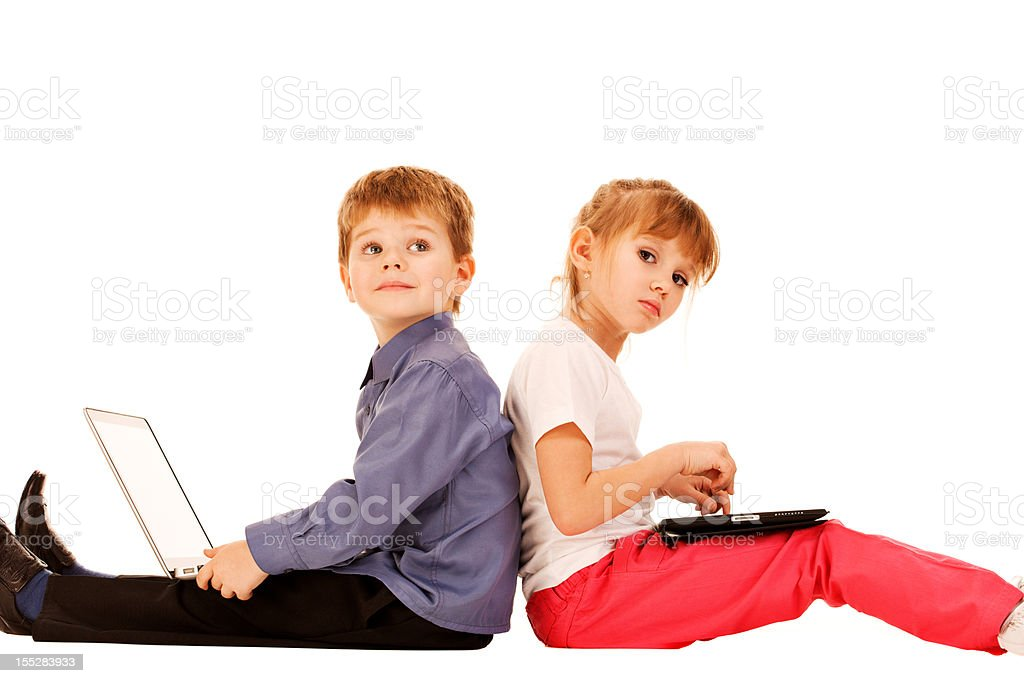 Brother and sister using electronic devices royalty-free stock photo
