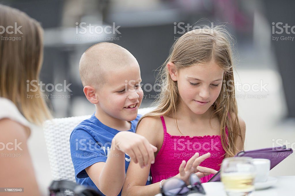 Brother and sister usinga digital tablet royalty-free stock photo