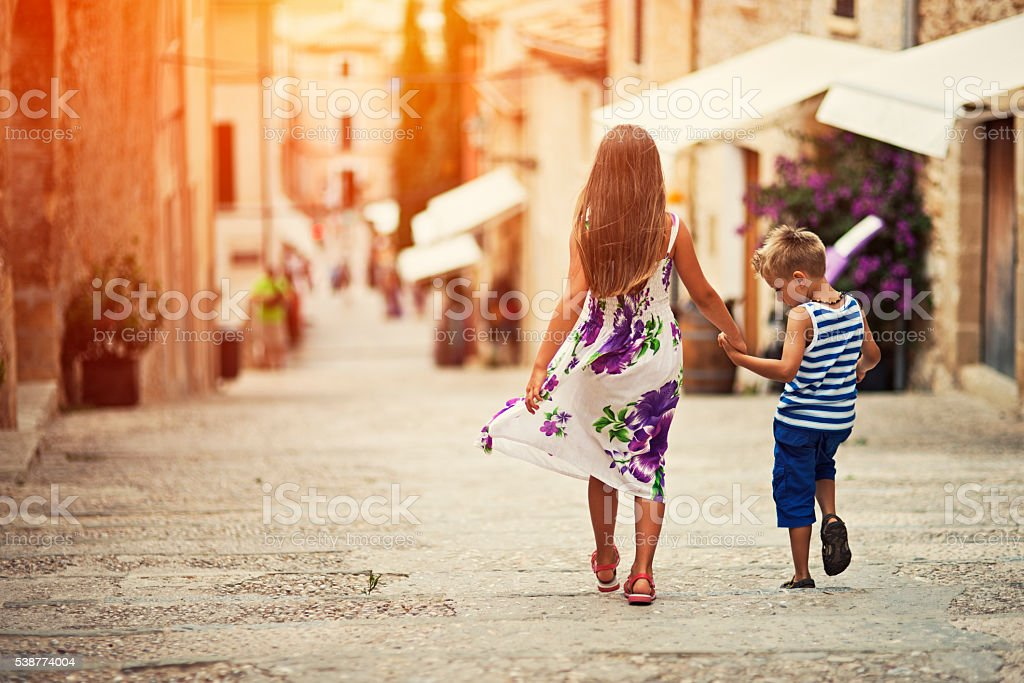 Brother and sister visiting mediterranean town stock photo
