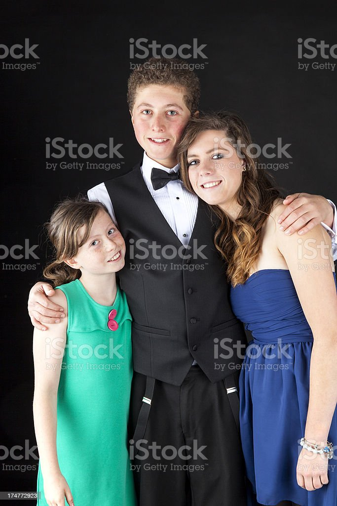 Brother And Sisters In Posh Clothes royalty-free stock photo