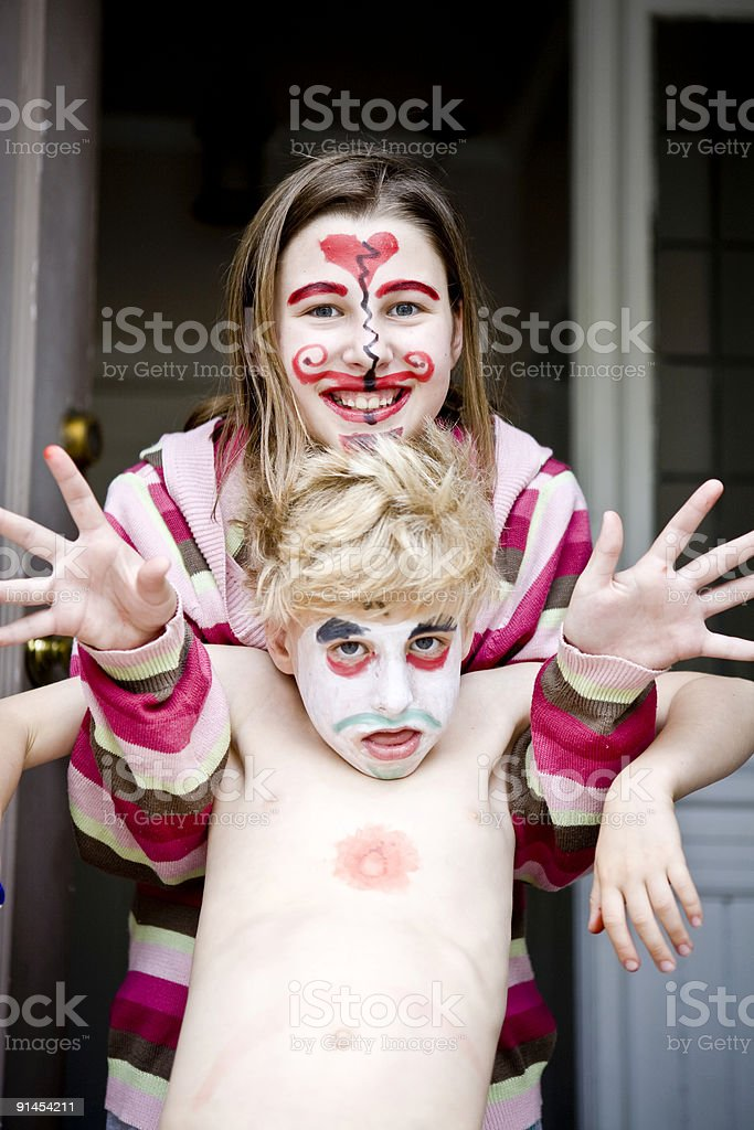 Brother & Sister with Painted Faces royalty-free stock photo