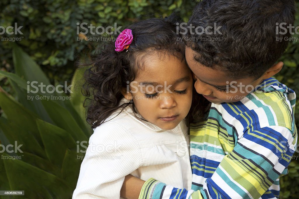 Brother taking care of his sister stock photo