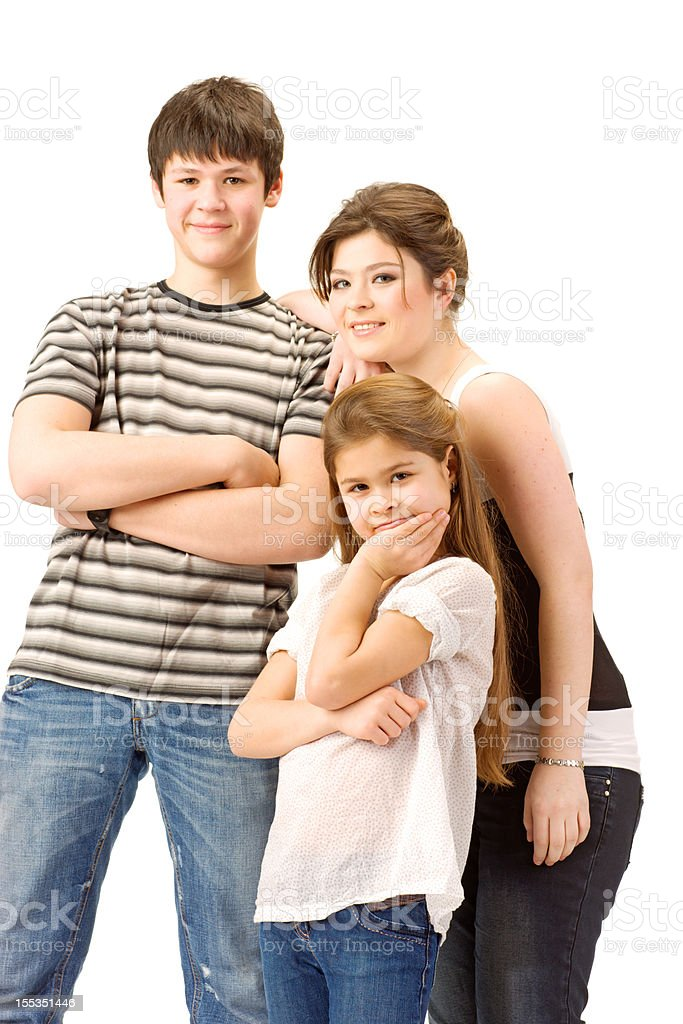Brother with Two Sisters posing on white background royalty-free stock photo