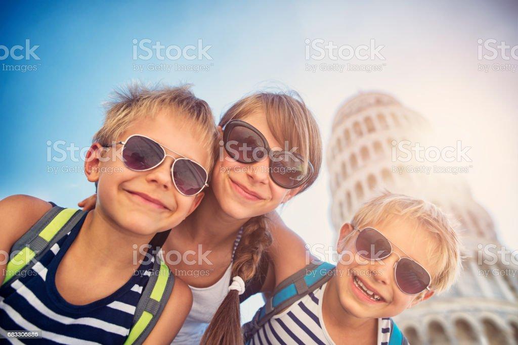 Brothers and sister having fun in Pisa foto stock royalty-free