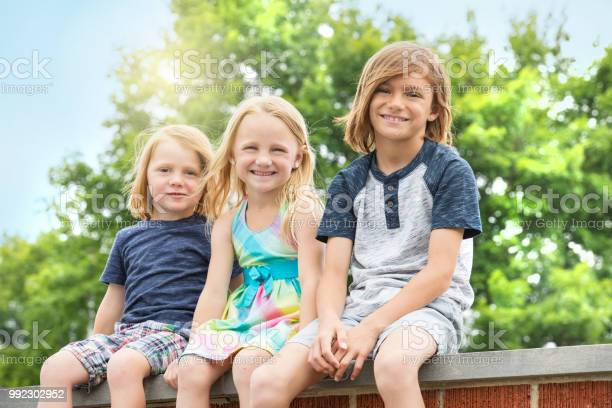 Brothers And Sister Outdoors Stock Photo - Download Image Now