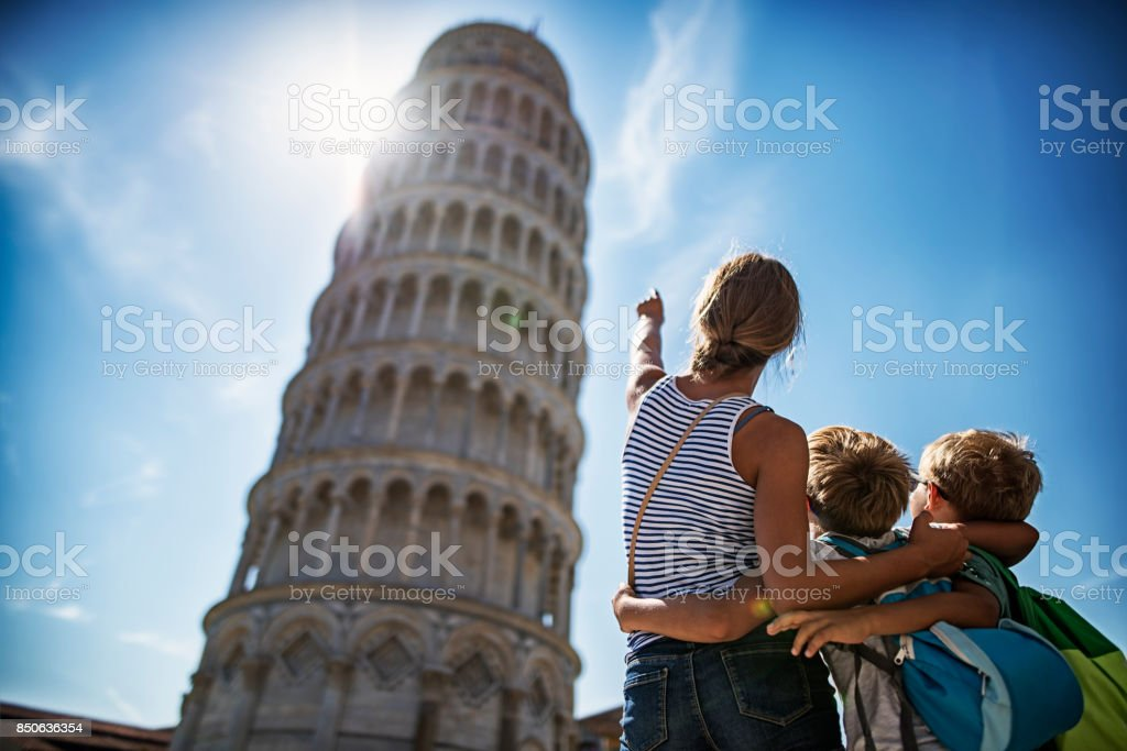 Brothers and sister sightseeing in Pisa stock photo