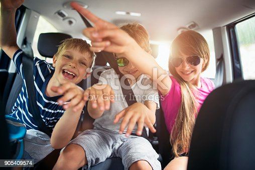 istock Brothers and sisters enjoying travelling by car 905409574