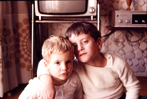 Vintage photo of brothers at home in the seventies.