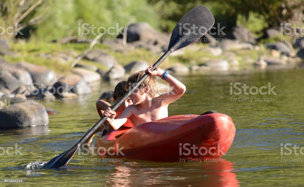 Brothers Enjoying the Kayak on Vacation stock photo