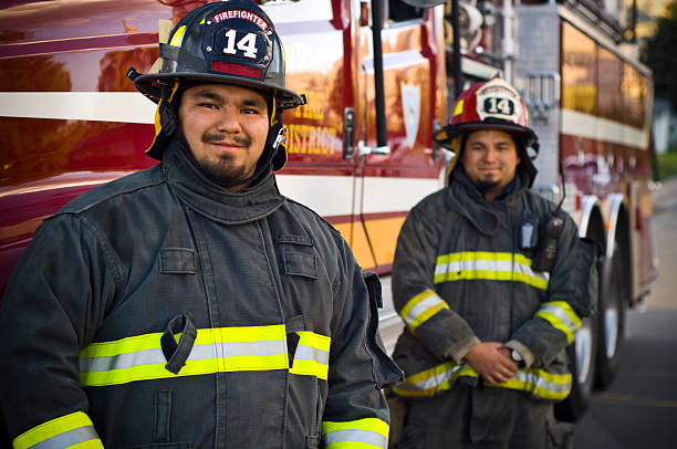 brothers firefighters - firefighter stock photos and pictures