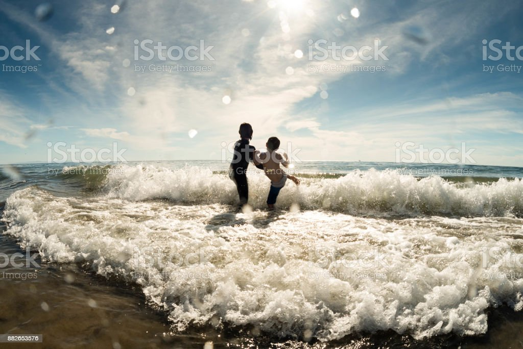 brothers karate chop the waves stock photo