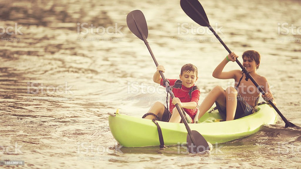 brothers kayaking royalty-free stock photo
