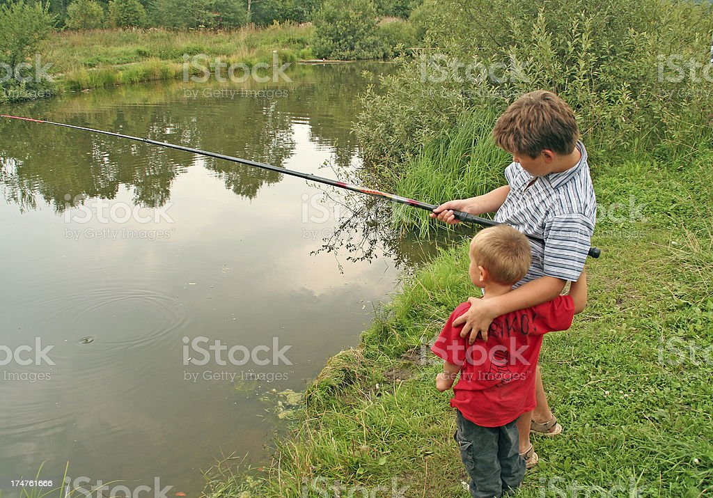 Brothers on fishing royalty-free stock photo