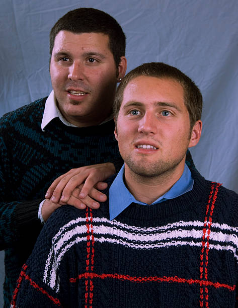 Brothers Brothers sitting silly embarrassment stock pictures, royalty-free photos & images