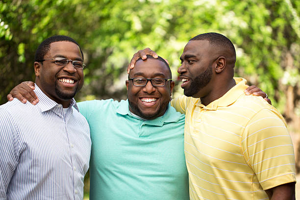 Brothers Brothers handing out laughing and talking. brother stock pictures, royalty-free photos & images