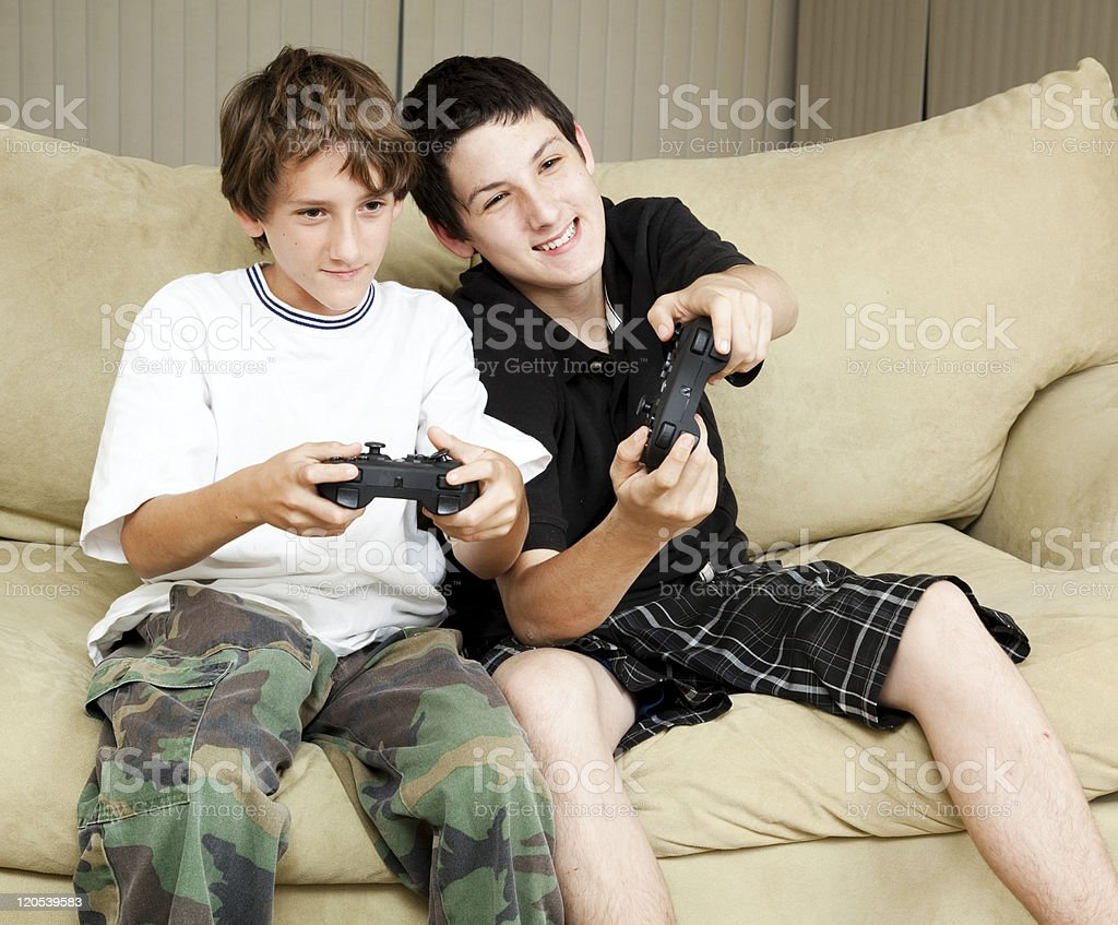 Brothers Play Video Games stock photo