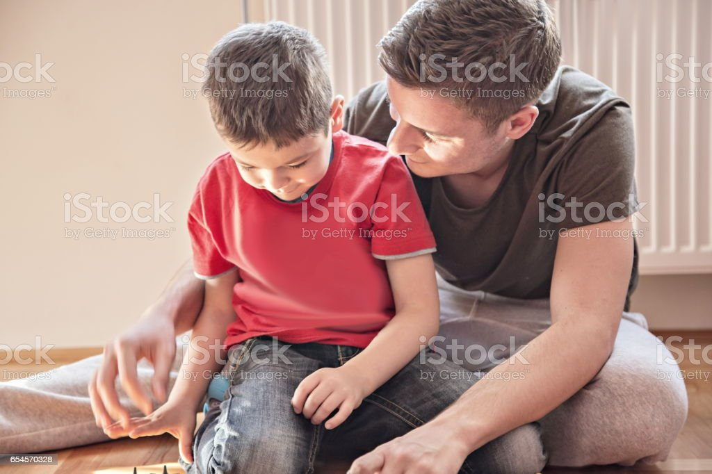 Brothers playing with car toys stock photo