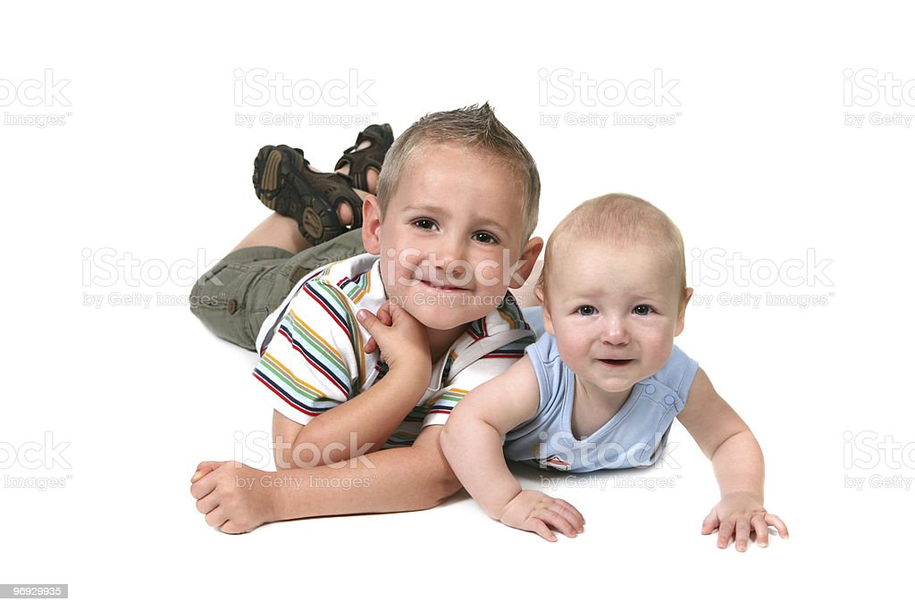 Brothers Posing for a Portrait Lying on Their Stomachs royalty-free stock photo