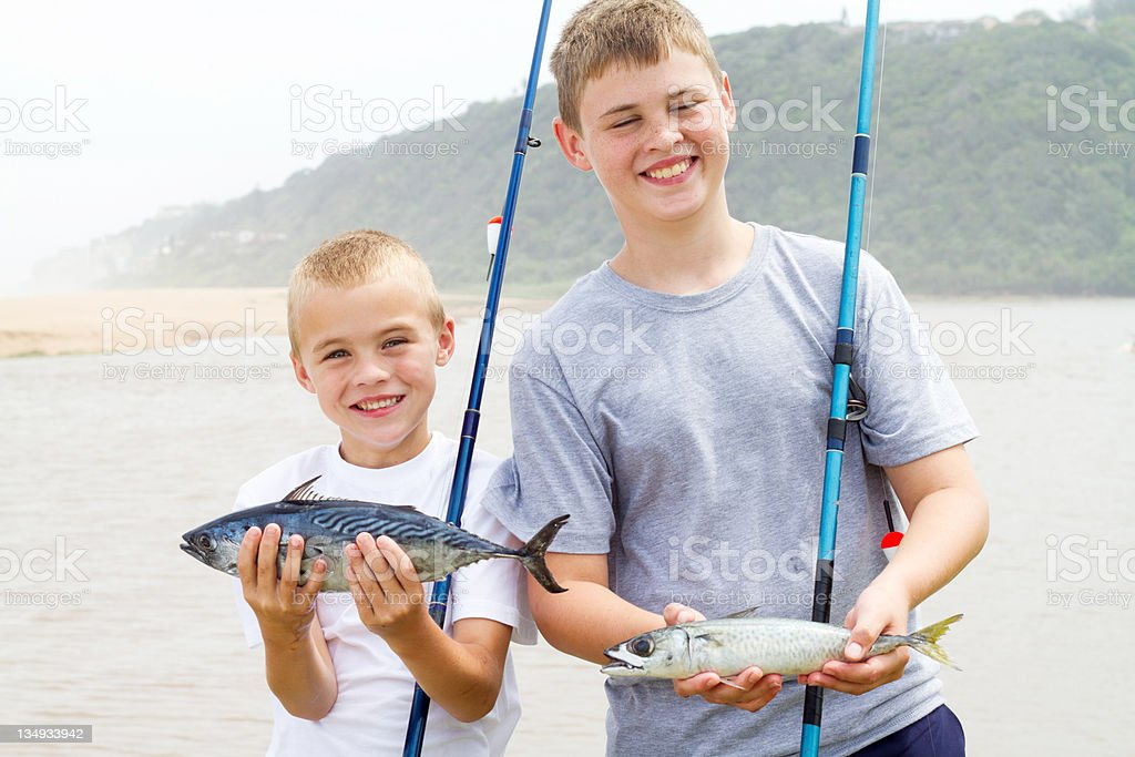 brothers showing catch of the day stock photo
