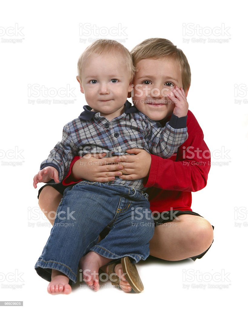 2 Brothers Smiling and Sitting Together  royalty-free stock photo