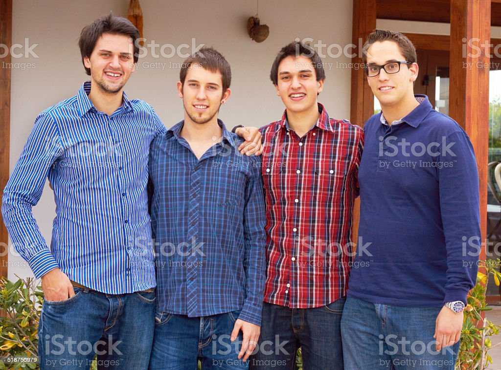 Brothers standing together stock photo