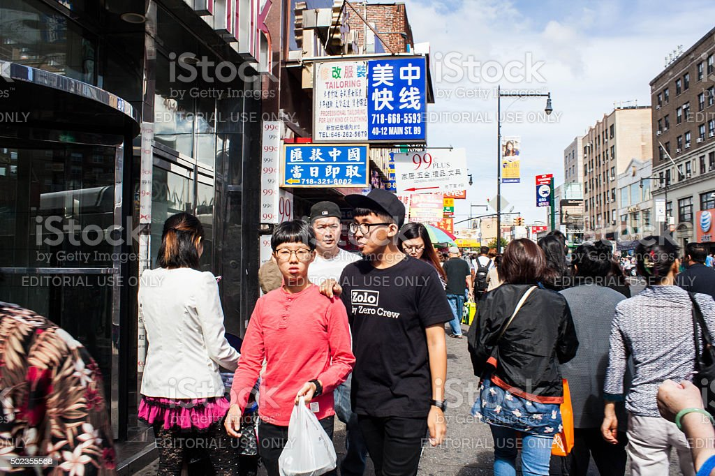 Brothers walking down Main Street in Flushing Queens' Chinatown stock photo
