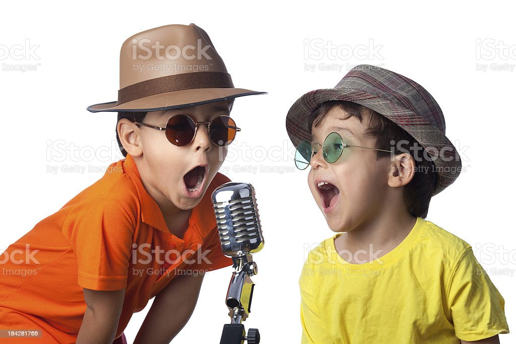 Brothers wearing hat singing on old fashioned microphone, white backgroun stock photo