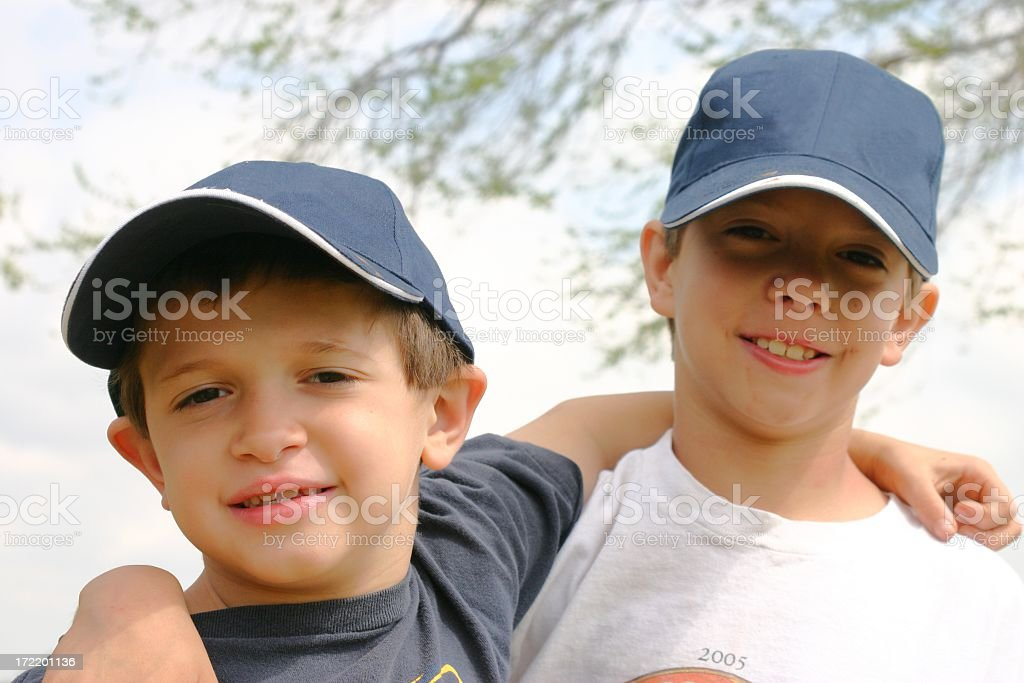 Brothers with arms around each other royalty-free stock photo