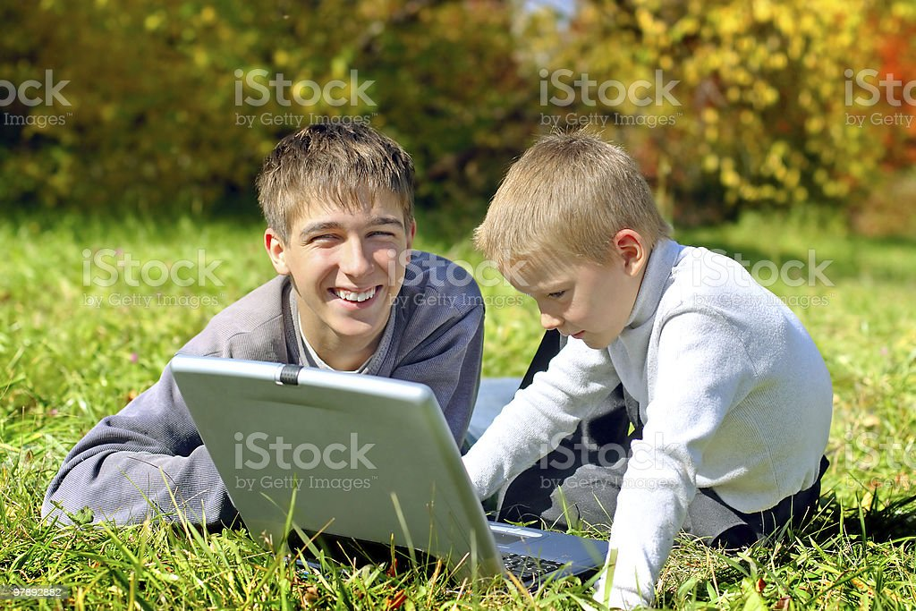 brothers with notebook royalty-free stock photo