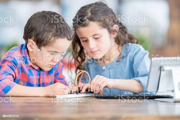 Foto de Equipe De Irmãos e mais fotos de stock de 6-7 Anos