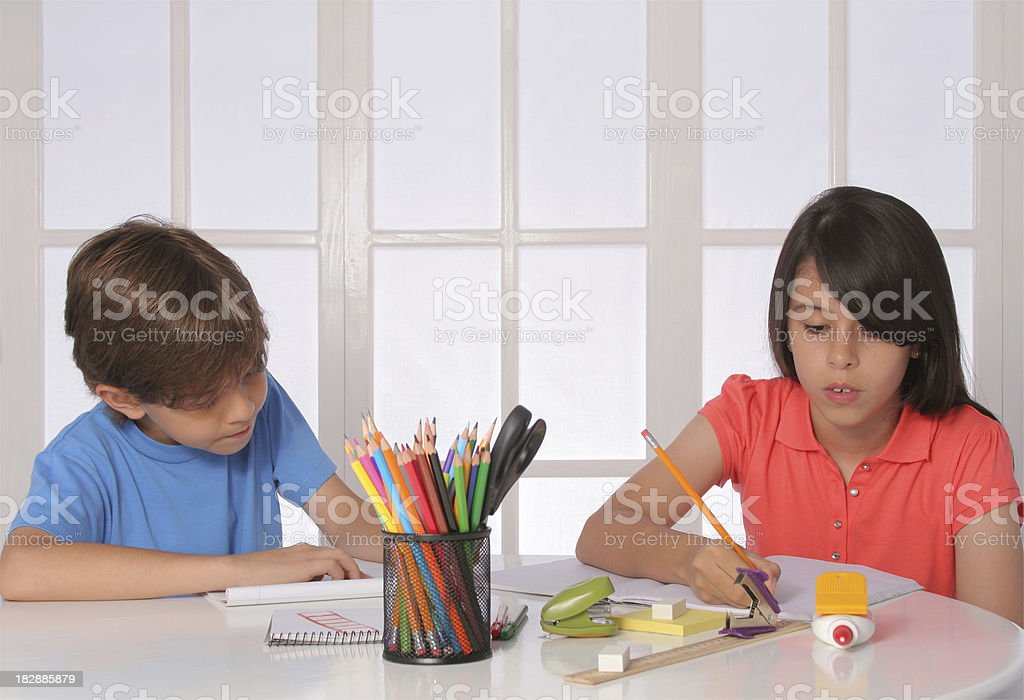 Brotther And Sister Doing Homework royalty-free stock photo