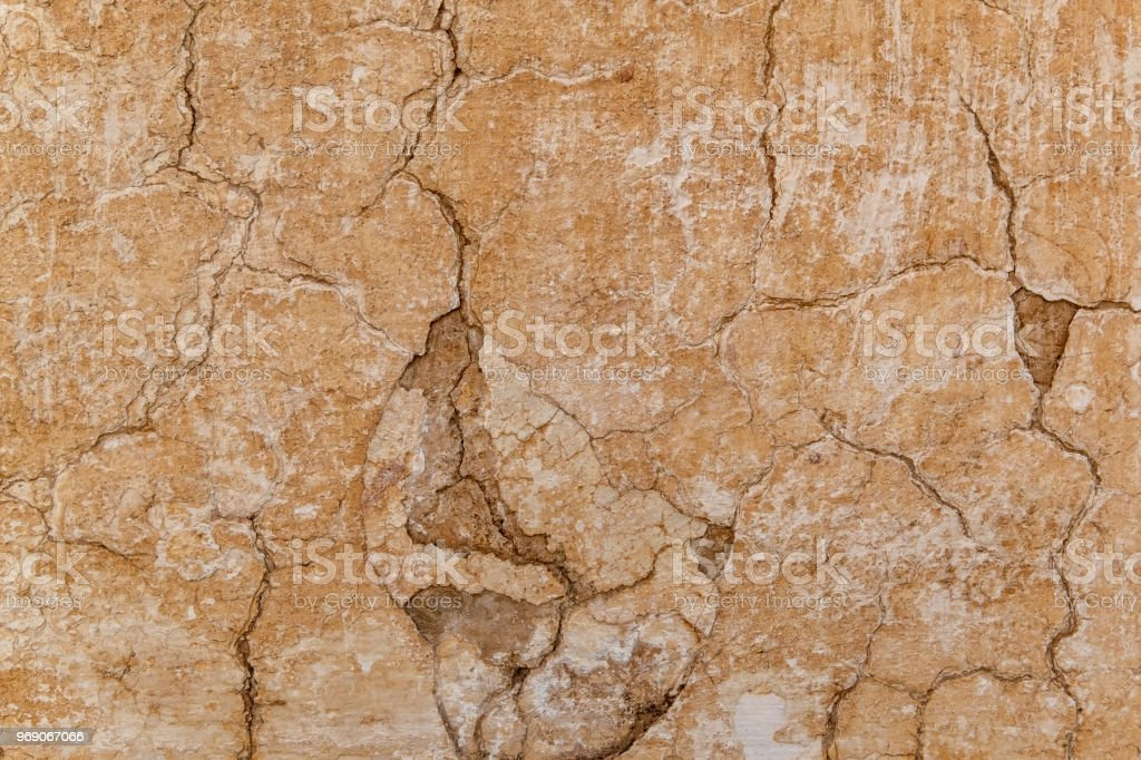 Brown adobe clay wall texture background. stock photo