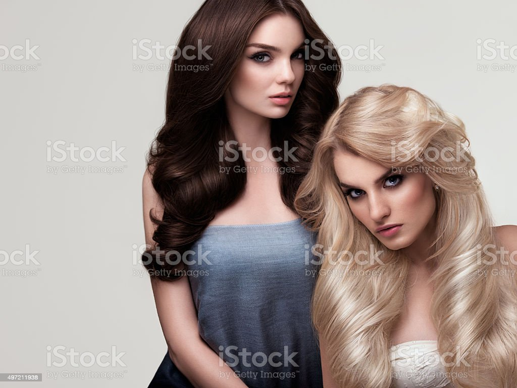 Brown and Blonde Hair. Portrait of Beautiful Woman's Long Hair stock photo